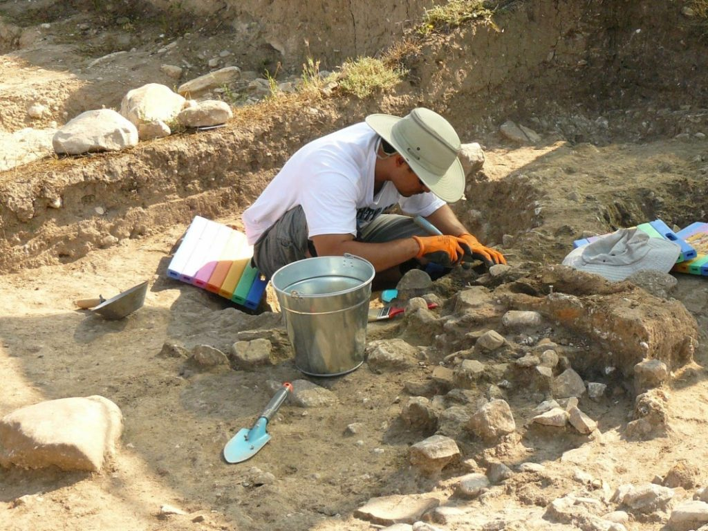 student of prehistoric archaeology learning to dig