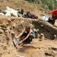 archaeology students excavating bronze age prehistoric site