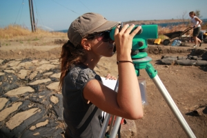 archaeology student learning to use dumpy level