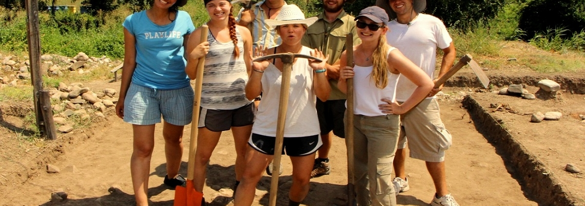 students and archaeologists on site