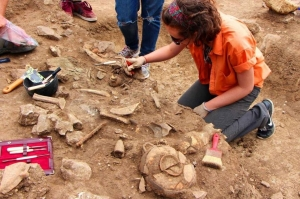student excavation of ancient archaeological site