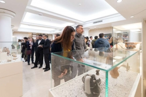 people at exhibition that protects balkan historical heritage