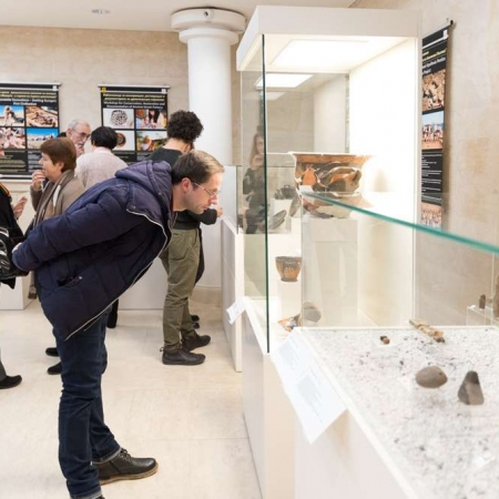 man looking at historical artefacts
