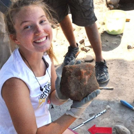 happy archaeology field school student