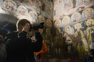 man holding a camera in medieval church